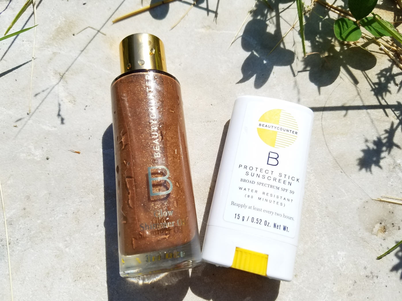 Better Beauty Vermont Glow Shimmer Oil travel size and small Protect Stick Sunscreen